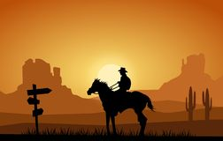 Cowboy in the far west. Rider at sunset through the Far West Stock Photo