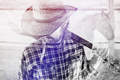 Cowboy Farmer with Guitar and Straw Hat on Horse Ranch Royalty Free Stock Image