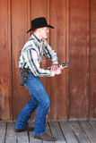 Cowboy Fastest Draw. Cowboy firing his six shooter Royalty Free Stock Images