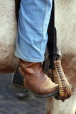 Cowboy foot in the stirrup of the horse Royalty Free Stock Images