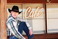 Cowboy in Front of Cafe Royalty Free Stock Images