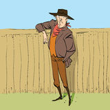 Cowboy in full figure standing near a fence. Hand drawn line art illustration Stock Images