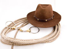 Cowboy gear. Western riding equipment, hat and rope Royalty Free Stock Images
