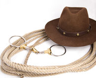 Cowboy gear. Western riding equipment, hat and rope Stock Photography