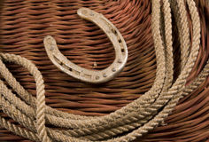 Cowboy gear. Western riding equipment, gloves, rope and a bit Royalty Free Stock Images