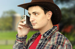 Cowboy getting forecast news on the radio Stock Photos