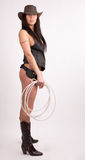 Cowboy girl. Art shot of a pretty model with rope and shell Stock Photo