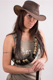 Cowboy girl. Art shot of a pretty model with shotgun Stock Photo