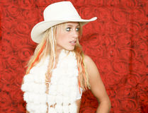 Cowboy girl. With hat on red rose background Royalty Free Stock Image