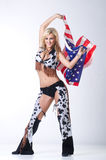 Cowboy girl with american flag. Royalty Free Stock Images