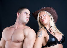 Cowboy girl and boy. Art shot of a pretty models royalty free stock photography