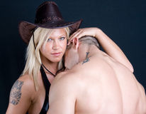 Cowboy girl and boy. Art shot of a pretty models stock photos