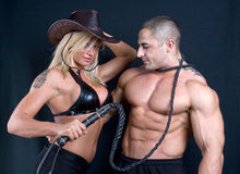 Cowboy girl and boy. Art shot of a pretty model with whip stock image