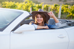 Cowboy girl driver in white convertible Stock Photography