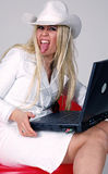 Cowboy girl and laptop Royalty Free Stock Photography