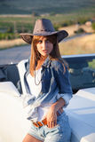 Cowboy girl stands at the convertible royalty free stock images