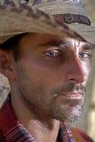 Cowboy Glance. A cowboy glances toward the camera Stock Photography