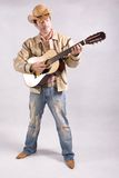 Cowboy in the guitar. Cowboy playing and learning how to play guitar stock photo