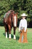 cowboy hans häst Arkivbild