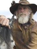 cowboy hans häst Arkivfoto