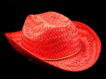 Cowboy hat. Red straw summer cowboy hat Royalty Free Stock Image