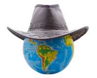 Cowboy hat. On the globe Royalty Free Stock Images
