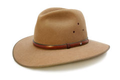 Cowboy Hat. Australian felt bush hat with leather band and opal.  Isolated on white Royalty Free Stock Images
