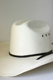 Cowboy Hat. White dress cowboy hat on off white background Stock Photos