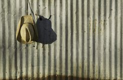 Cowboy hat against corrugated metal. royalty free stock photography