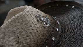 Cowboy hat with an anchor logo. Close-up stock video footage