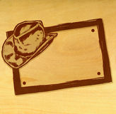 Cowboy Hat Banner. A hand drawn cowboy hat banner / sign. Just add text! Wood background version Stock Image