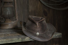 Cowboy hat in the barn. A cowboy hat on a shelf in the barn royalty free stock images
