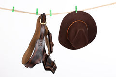 Cowboy Hat and Belt On A Clothesline Royalty Free Stock Image