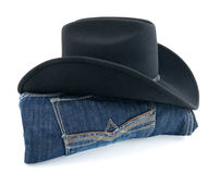 Cowboy hat and blue jeans Stock Image