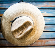 Cowboy hat on blue plank wall Stock Photos