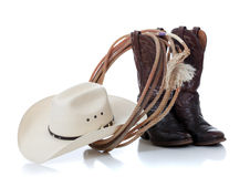 Cowboy hat, boots and lariat on white stock images
