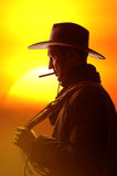 Cowboy in hat silhouette Stock Photography