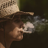 Cowboy in hat with cigar silhouette Royalty Free Stock Images