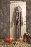 Cowboy hat and coat haning on a barndoor, Royalty Free Stock Photography