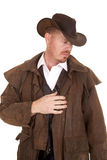 Cowboy in hat and duster hand on heart Royalty Free Stock Photography