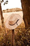 Cowboy hat on fence Stock Photography