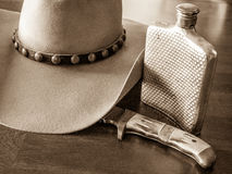 Cowboy Hat, Flask, Knife Stock Images