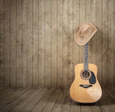 Cowboy hat and guitar Royalty Free Stock Images