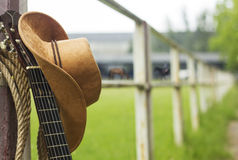 Cowboy hat and guitar. American country music background stock photos