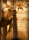 Cowboy hat and guitar.American music background Royalty Free Stock Image