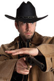 Cowboy with hat and gun Royalty Free Stock Photography