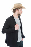 Cowboy hat in hand of happy businessman in suit jacket Royalty Free Stock Photos