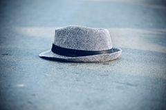 A cowboy hat kept on the road - stock photograph. The beautiful stylish cowboy hats kept on top of a surface of the road unique stock photograph stock image