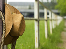 Cowboy hat and lasso on fence American ranch. Cowboy hat and lasso on fence American Horse ranch background stock photos