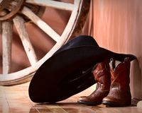 Cowboy hat leaning on boots Stock Photography